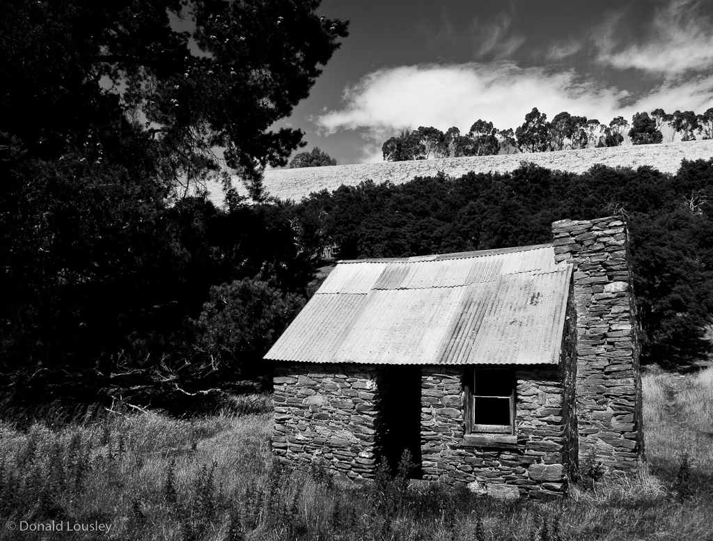 Farm Cottage at the foot of the Grandview Range Central Otago by Donald Lousley.