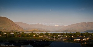 Sunrise with a full moon over Lake Wanaka by Donald Lousley.