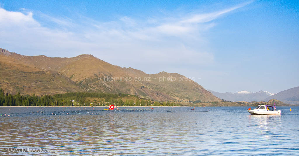 Triathlon Swimmers and Boat on Lake Wanaka by Donald Lousley.